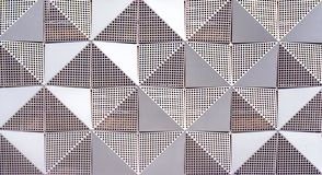 Geometric shapes on the wall surface royalty free stock photo