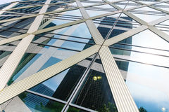 Modern facade of glass with cloudy sky and reflections Royalty Free Stock Photos