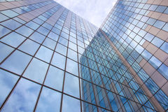 Modern facade of glass and steel with cloudy sky Royalty Free Stock Photography