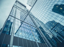 Modern facade of glass and steel reflecting sky Royalty Free Stock Photo