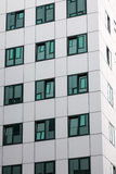 Modern facade of office building with reflections in windows Royalty Free Stock Photo