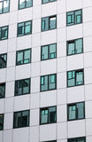 Modern facade of office building with reflections in windows Stock Photography