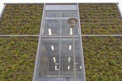 Modern facade. Modern office façade with aluminium window frame and grass roof feature, Welwyn garden city, England royalty free stock image