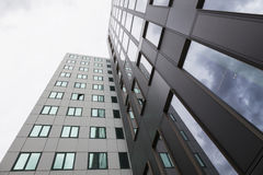 Modern facades of office buildings and reflections of clouds in Stock Photography