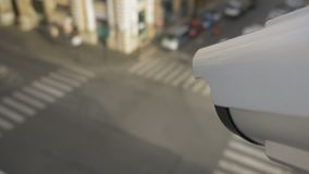 Surveillance camera with facial recognition technology. Modern facial recognition technology, moving surveillance camera on the street recording traffic flow and stock video footage