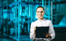 Modern factory worker. Technology blue milk production Stock Image