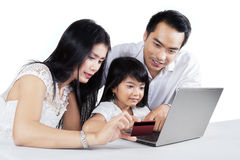 Modern family buying online at home Royalty Free Stock Photo