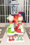 Modern family Christmas table with Carol Singing Ornaments stock image
