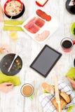 Modern family having breakfast Royalty Free Stock Photo
