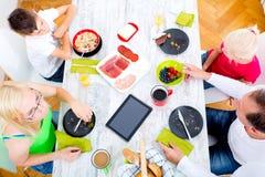 Modern family having breakfast Stock Photo