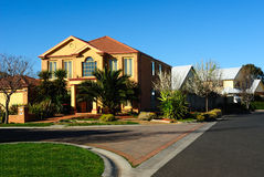 Modern family home on a new street royalty free stock photos