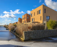 Modern family houses along a river Royalty Free Stock Image
