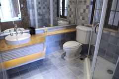 A modern family toilet. With shower,ceramic basin stand Royalty Free Stock Images