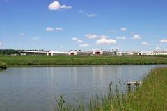 Modern farm. Buildings on lakeside Stock Photos
