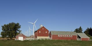 Modern Farm. This is a Fall picture of a modern family farm , traditional buildings, traditional crops, but a modern crop of wind turbines spread through the Royalty Free Stock Photos