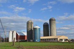 Farm with silos and grain driers Royalty Free Stock Photos