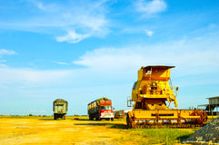 Modern farming equipment. Modern harvester combine and trucks during harvest time at Paddy field near Sekinchang Malaysia Stock Photography