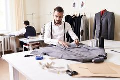 Modern Fashion Designer Working in Atelier Royalty Free Stock Images