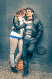 Modern fashion hipster couple of young lovers in autumn. Modern couple of young lovers with autumn clothes ready for the upcoming winter - Deep moment of a love Royalty Free Stock Photos