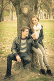 Modern fashion hipster couple of young lovers in the park Stock Photography