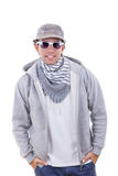 Modern fashion man in sweatshirt wearing cap and scarf with sung Stock Photos