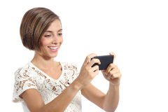 Modern fashion woman watching video in a smart phone Stock Image