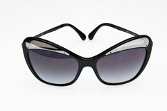Fashionable graphite sunglasses of Chanel brand stock images
