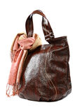 Modern fashionable female bag and scarf with tassels. Stock Photo