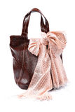 Modern fashionable female bag and scarf with tassels. Royalty Free Stock Images