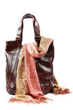 Modern fashionable female bag and scarf with tassels. Royalty Free Stock Photo