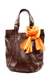 Modern fashionable female bag and scarf with tassels. Royalty Free Stock Photos