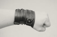 Modern fashionable leather and metal bracelets on the wrist. Modern fashionable leather and metal bracelets on the wrist stock image