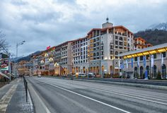 Modern fashionable Marriott Krasnaya Polyana Hotel in Gorky Gorod winter mountain ski resort fronts on the federal motorway. Sochi, Russia - February 27, 2014 royalty free stock image