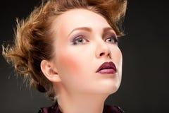 Modern fashionable woman over gray Royalty Free Stock Photos