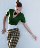 Modern fashionable woman in trousers posing Royalty Free Stock Images