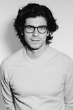 Modern fashionable young man in glasses. Stock Photos