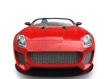 Modern fast raging red convertible  sports car - front view closeup shot Royalty Free Stock Photos