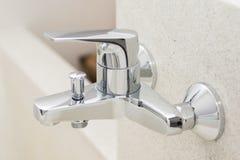Modern faucet on bathtub Stock Photos