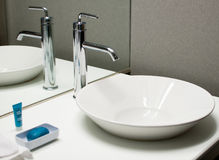 Modern faucet and sink Stock Photos