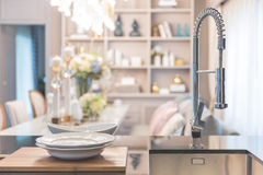 Modern faucet sink in pantry with luxury dining room. As background royalty free stock images