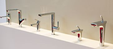 Modern faucets. For washbasin and sink Royalty Free Stock Photos