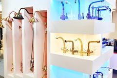 Modern faucets and shower in store. Modern faucets and shower in the store royalty free stock photo