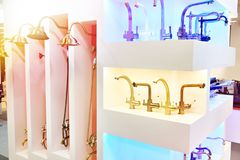 Modern faucets and shower in store. Modern faucets and shower in the store stock image