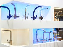 Modern faucets. For washbasin and sink stock images