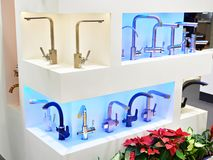 Modern faucets. For washbasin and sink stock photography