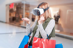 Modern female customer experience virtual reality. Thru vr headset in the mall Stock Photo