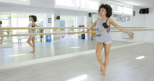 Modern female dancer in bright studio practicing Stock Photography