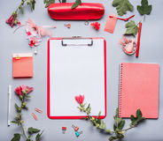 Modern feminine office desk table with clipboard with empty copy space blank for list or for input the text, flowers and other su. Pplies, Top view, flat lay Royalty Free Stock Photography