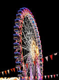 Modern ferris wheel in the night. Free time activities royalty free stock photos