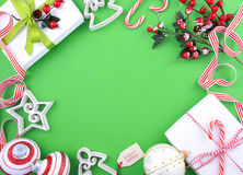 Modern festive green, white and red theme Christmas holiday back. Ground with decorated borders with copy space stock image